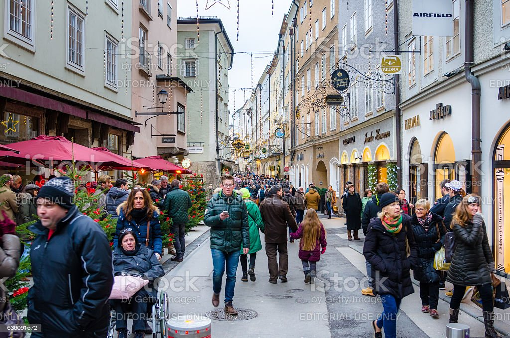 People Walking along a Shopping Street in Salzburg Old Town stock photo