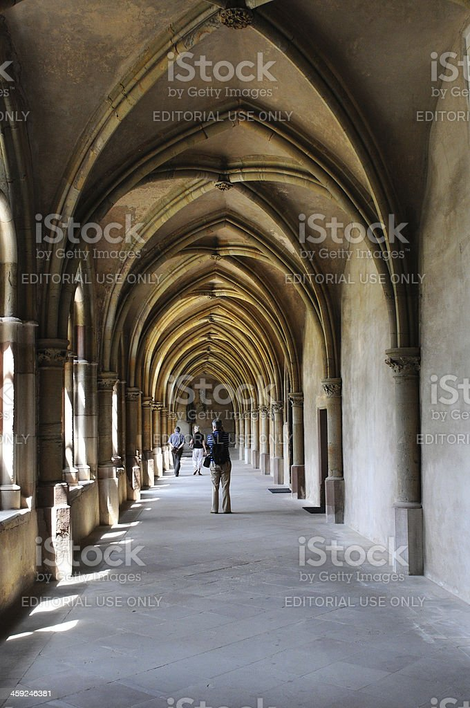 People walking along at cloister of Cathedral Trier stock photo