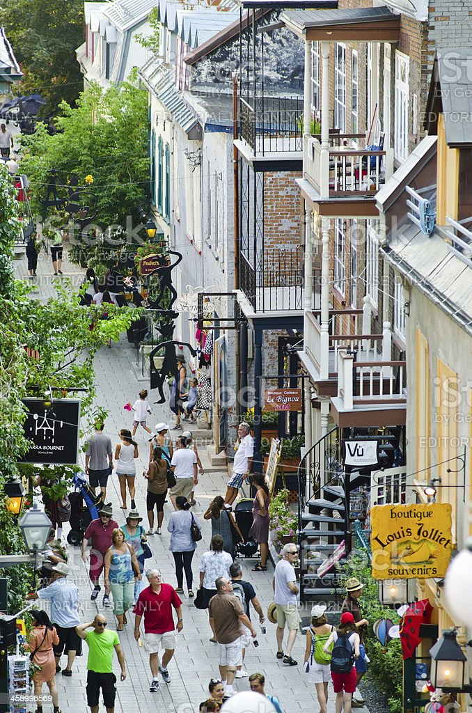 People walking along Rue du Petit-Champlain in Quebec City, Canada royalty-free stock photo