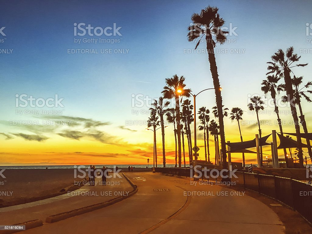 People walking along the beach, California, USA stock photo