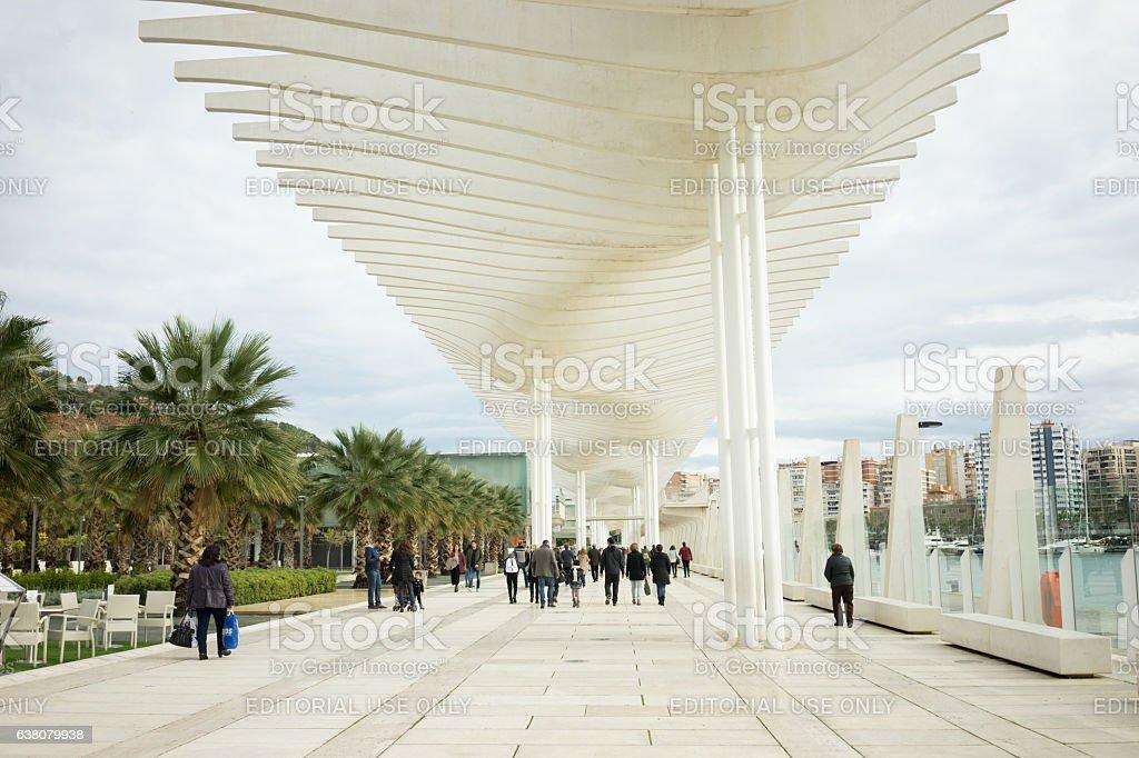 People walking along the modern structure, promenade stock photo