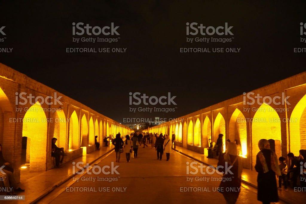People walking along the Si-o-se Pol in Isfahan, Iran stock photo
