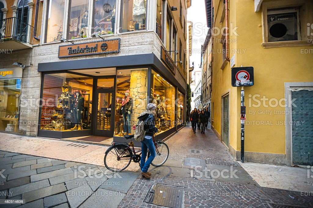 People walking and cycling on Verona Street, Italy stock photo