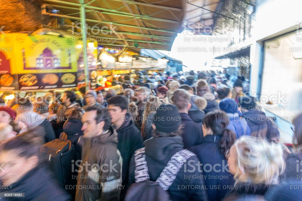 People walking and shopping at Camden Market in London stock photo