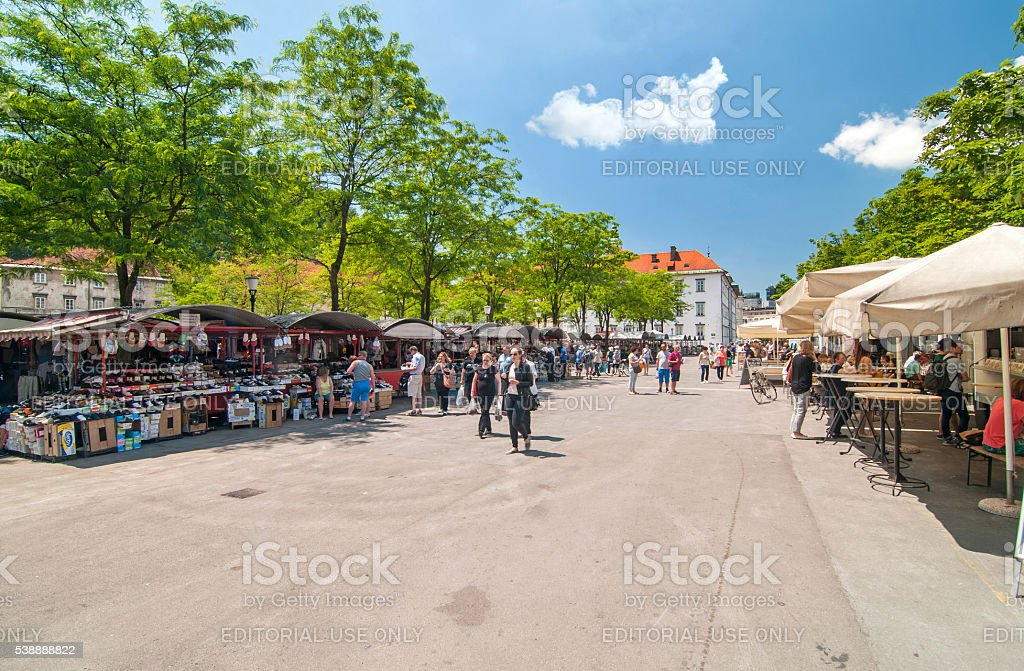 People walking and shopping in Ljubljana's central market stock photo