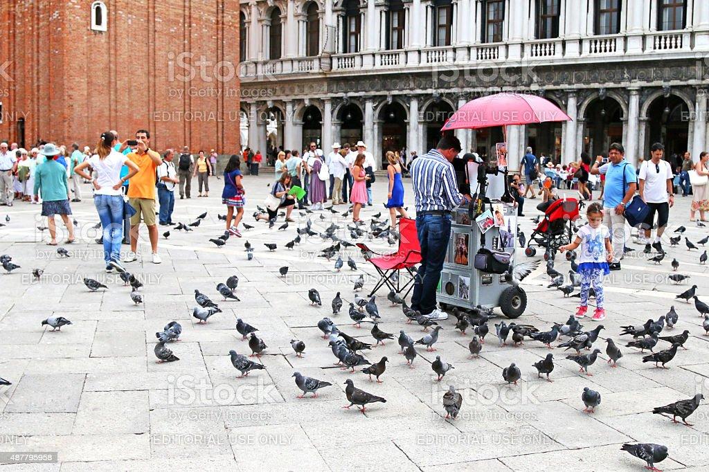 People walking around at St Mark's Campanile, Italy stock photo