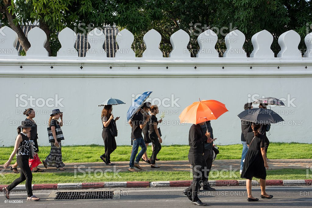 People  walking around Great Palace  to pay respect deceased King stock photo