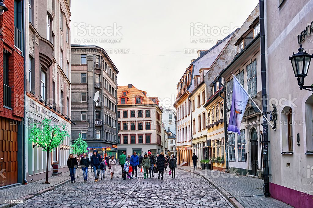 People walking around in old town of Riga stock photo