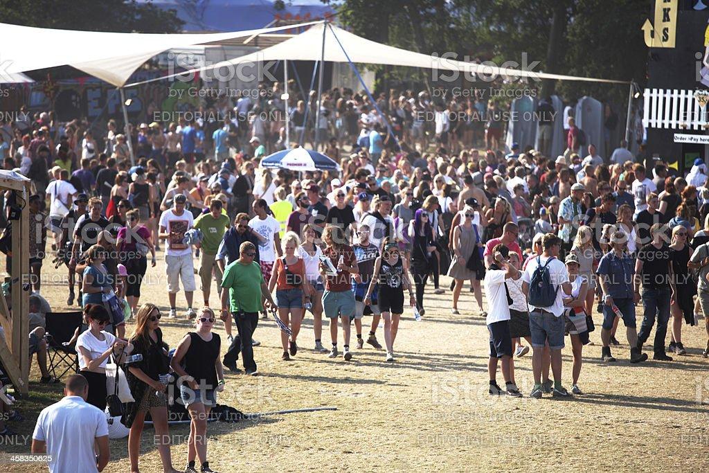 People walking around on Roskilde Festivalsquare stock photo