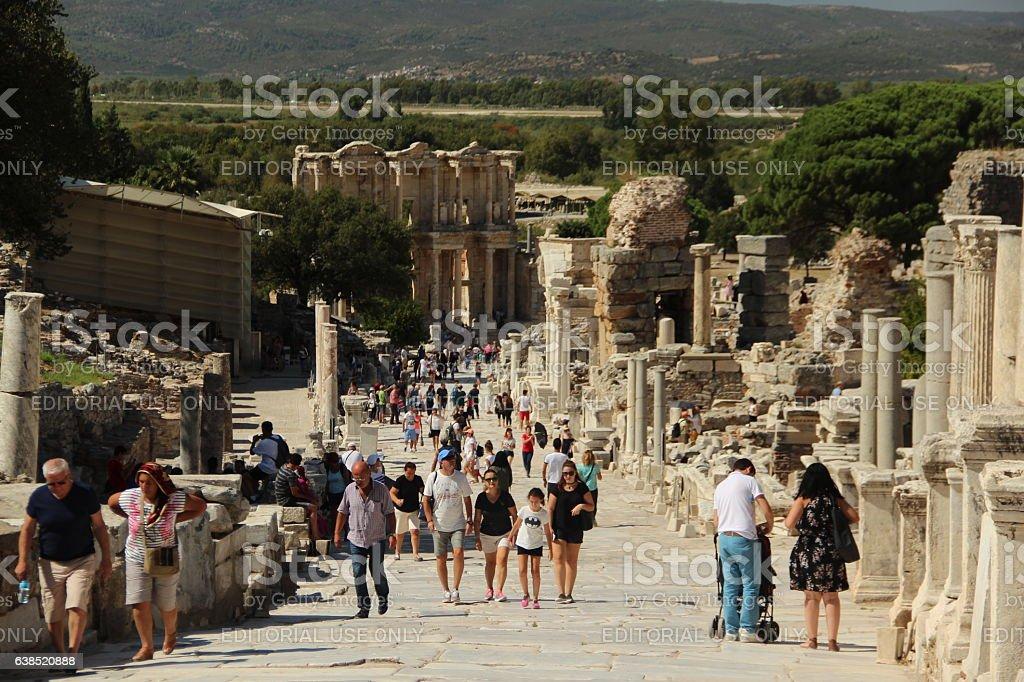 People walking around ruins of ancient city Ephesus in Selcuk stock photo