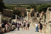 People walking around ruins of ancient city Ephesus in Selcuk