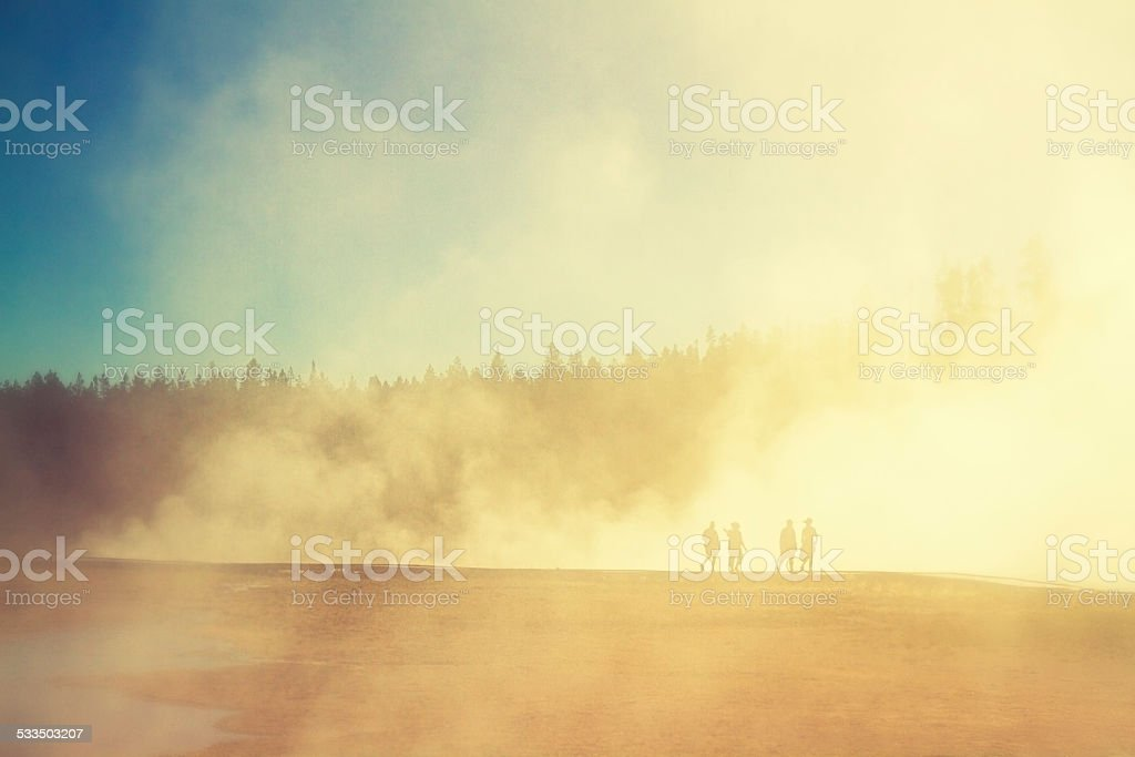 People walking around the Grand Prismatic In Yellowstone National Park stock photo