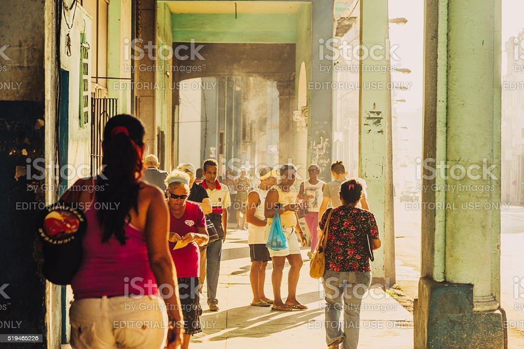 people walking around the streets of Havana, Cuba stock photo