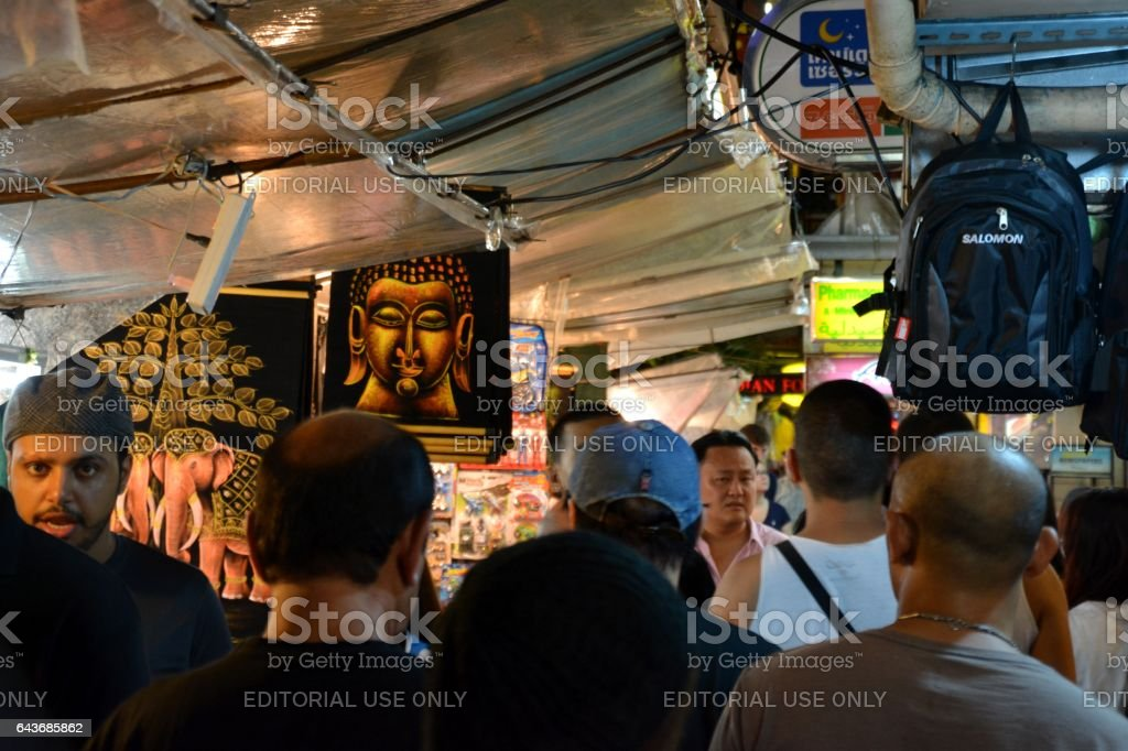 People walking at night street market on Sukhumvit road, Bangkok stock photo