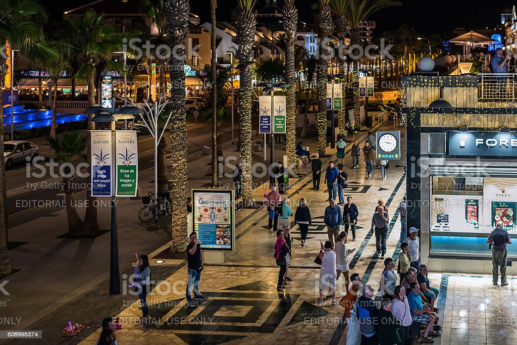 People walking at night street of Las Americas town stock photo
