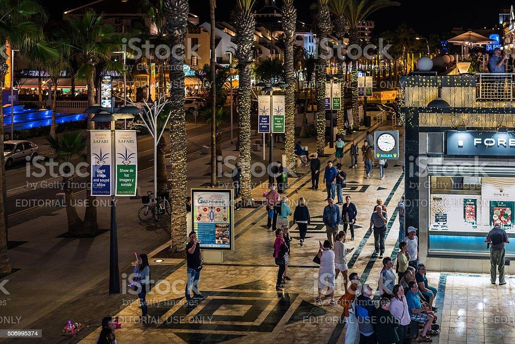 People walking at night street of Las Americas town stock photo