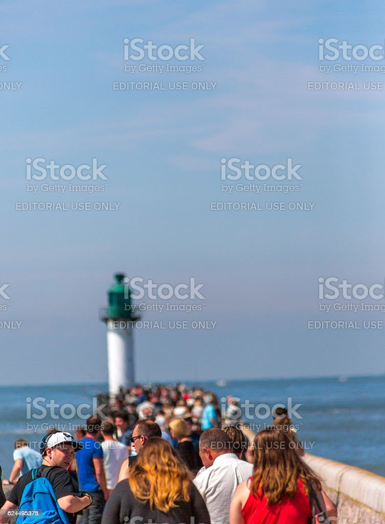 People walking at pier with sealantern coast of calais france stock photo
