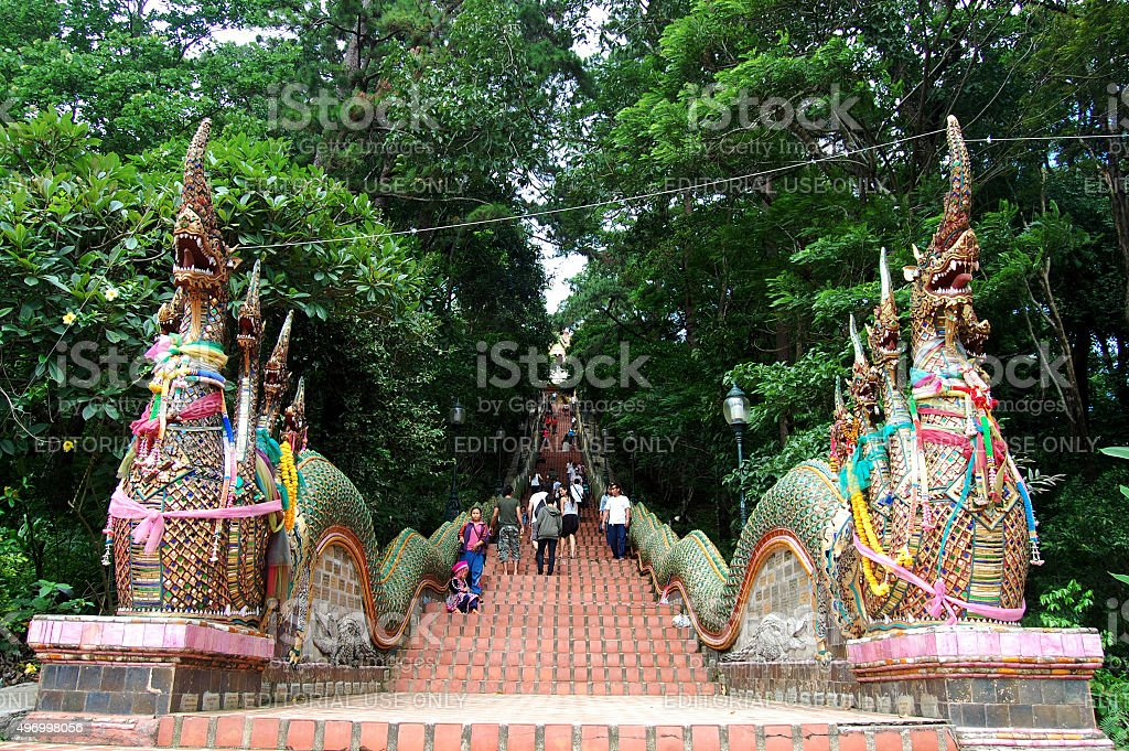 People walking at stairs of Wat Phra That Doi Suthep stock photo