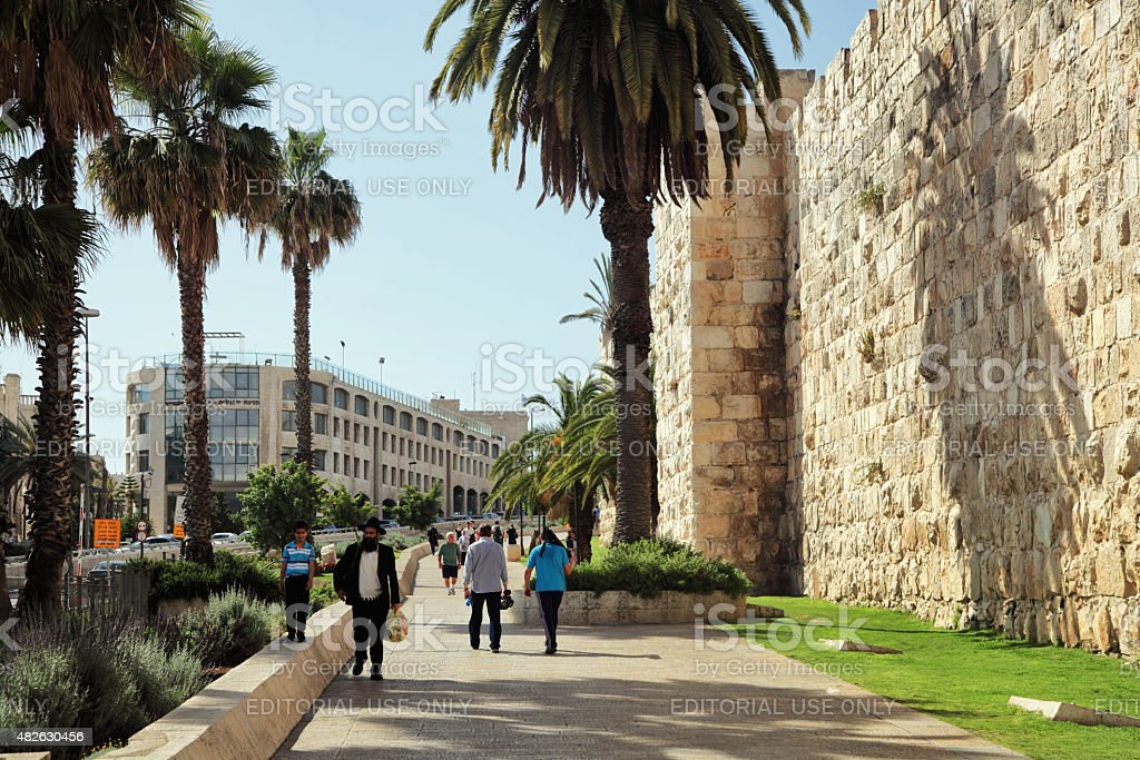 People walking by the Old City of Jerusalem stock photo