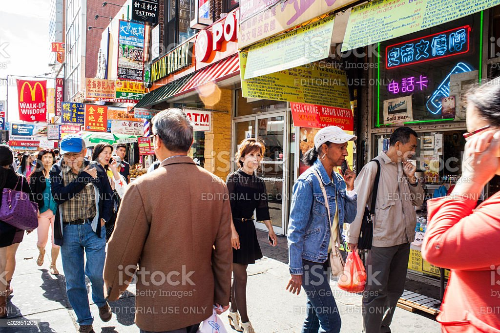 People Walking down a busy street in Flushing Queens' Chinatown stock photo