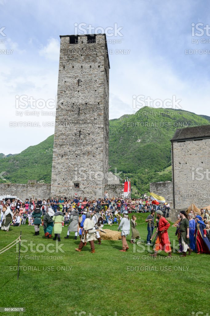 People walking during a parade of medieval characters stock photo