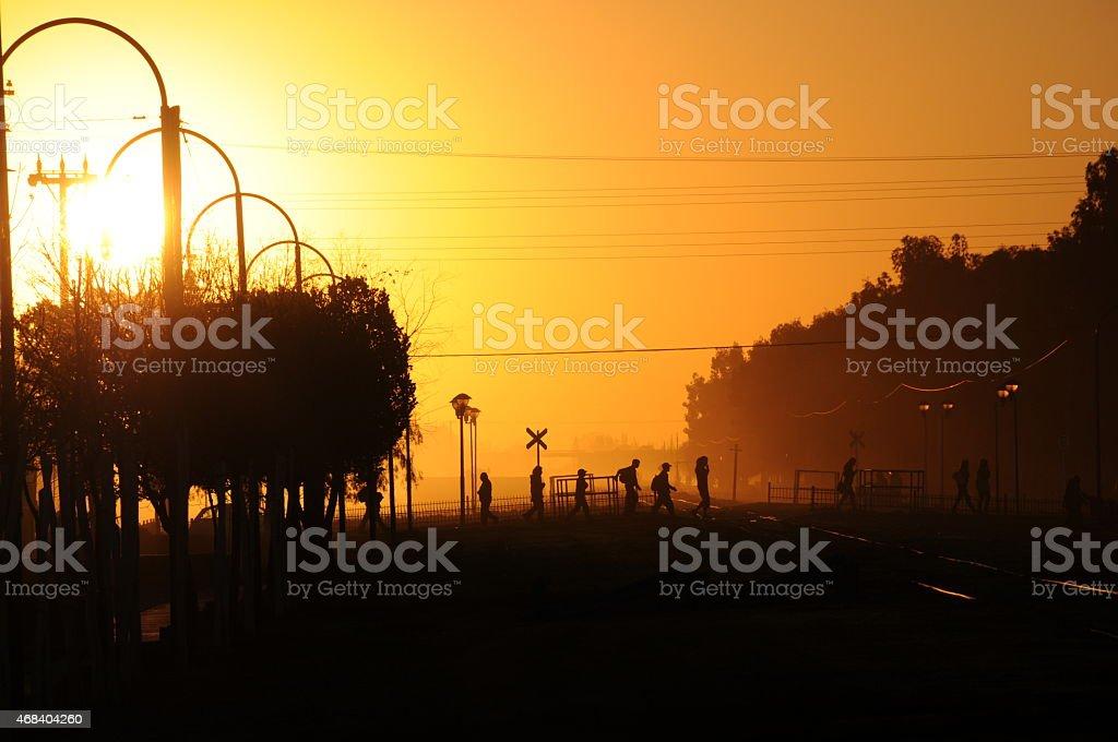 People walking in a beautiful sunset stock photo