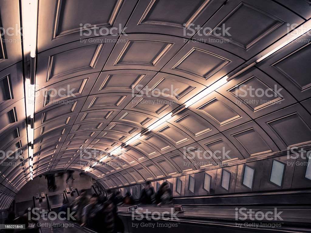 People walking in a tunnel of subway station, London royalty-free stock photo