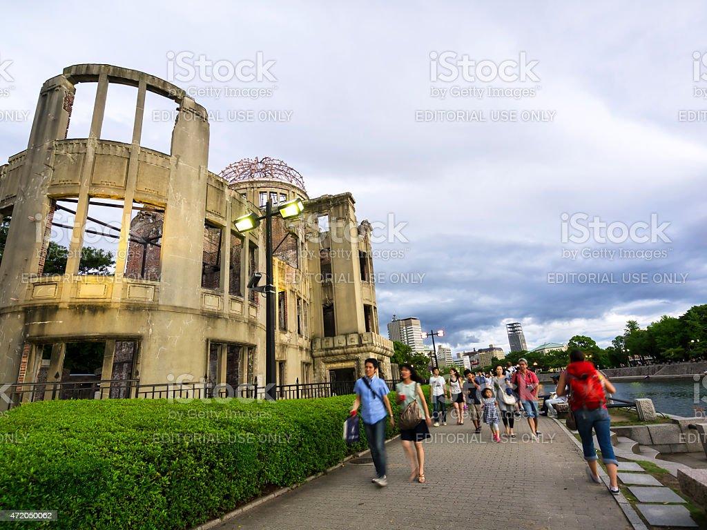 People walking in Atomic Dome Memorial Park, Hiroshima stock photo