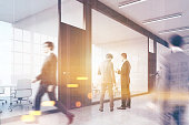 People walking in business center lobby
