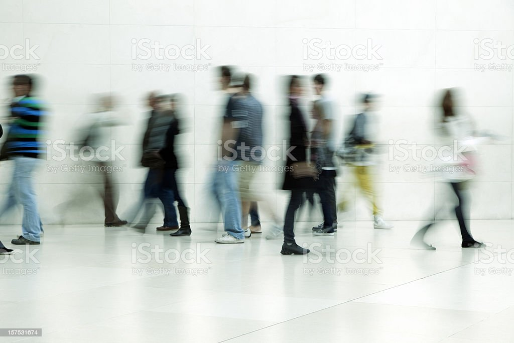 People walking in corridor, blurred motion stock photo
