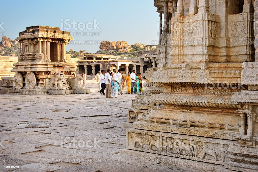 People walking in courtyard of Vittala Temple  in Hampi, India. stock photo