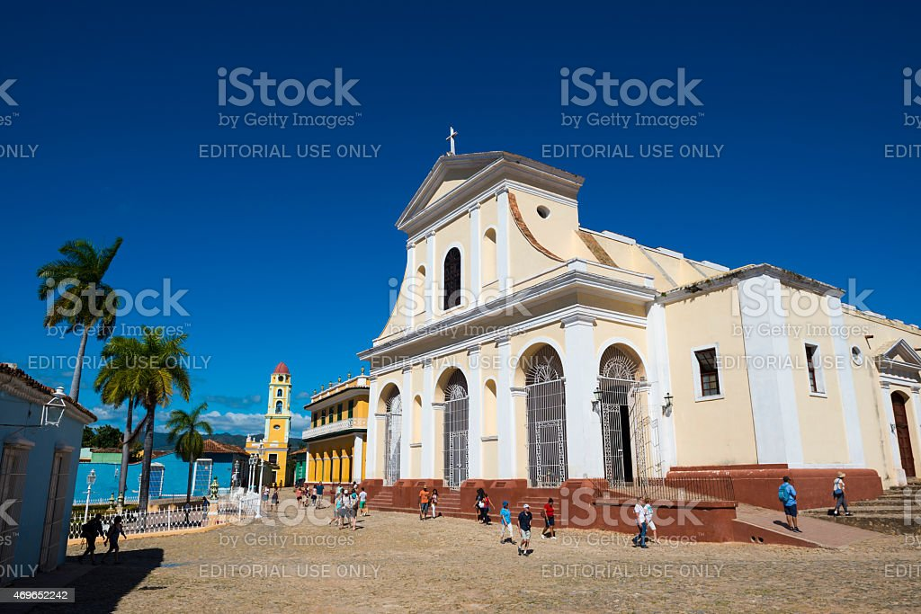 People walking in front of Holy Trinity Church Trinidad, Cuba stock photo
