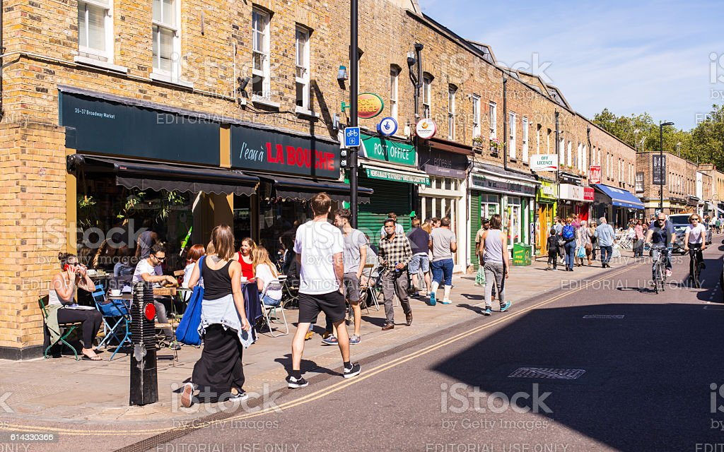 People walking in front of local restaurants in Broadway Market stock photo