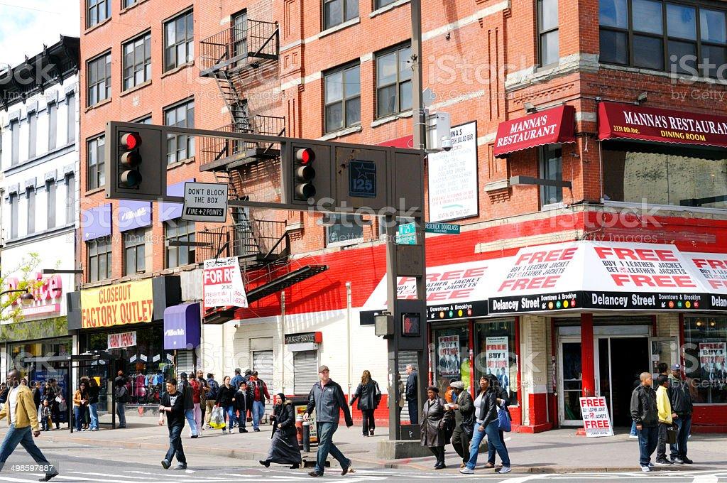 People Walking in Harlem, NYC. stock photo