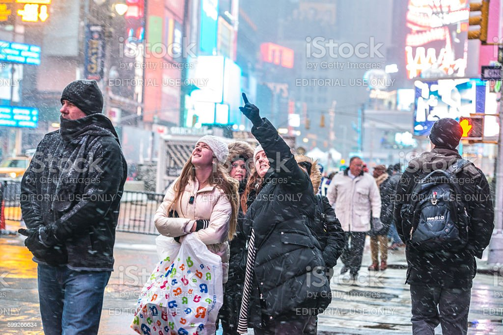 People walking in heavy snowstorm, Times Square, New York stock photo
