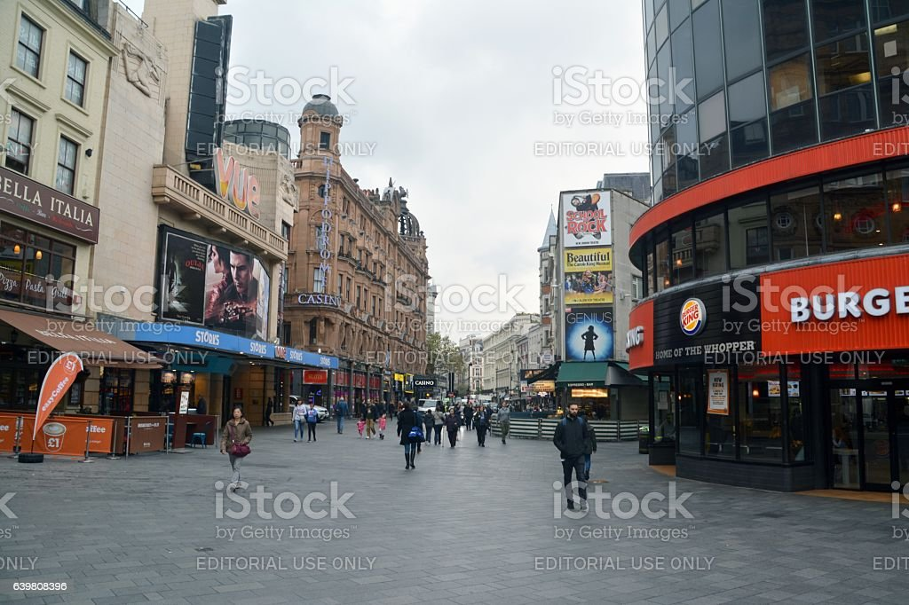 People walking in Leicester Square, London, UK stock photo