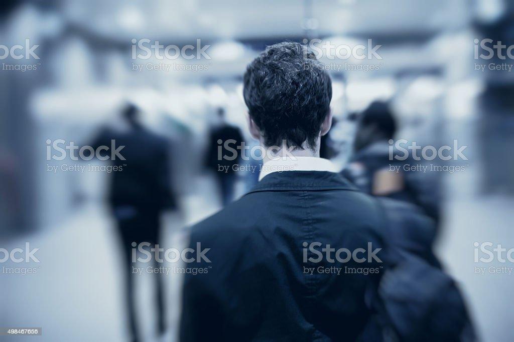 people walking in metro stock photo