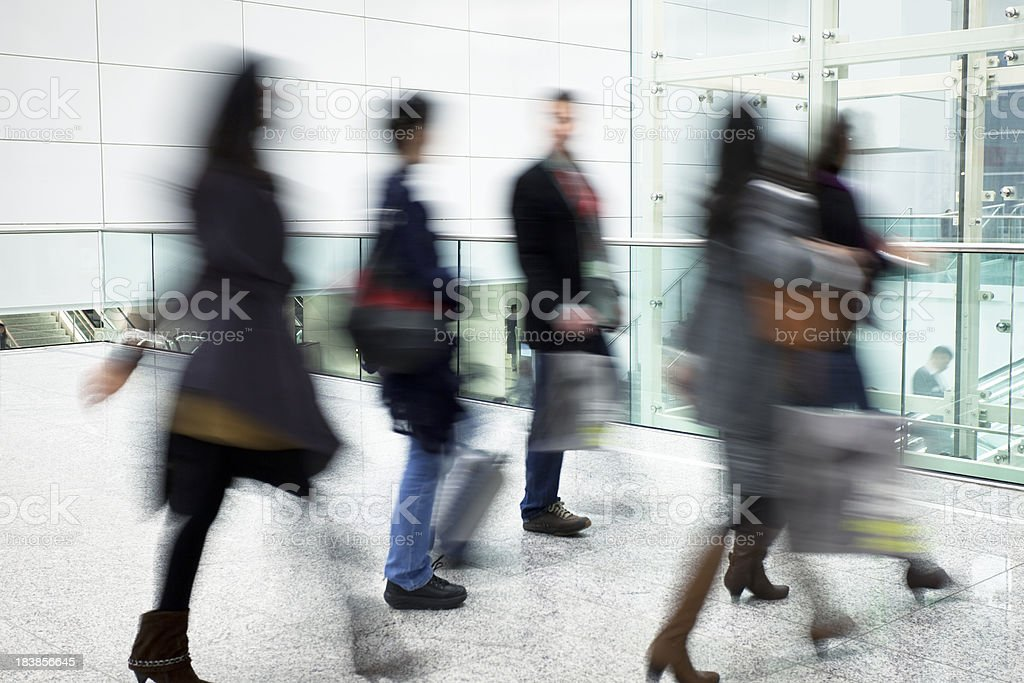 People Walking in Modern Bright Interior With Glass Elevator royalty-free stock photo
