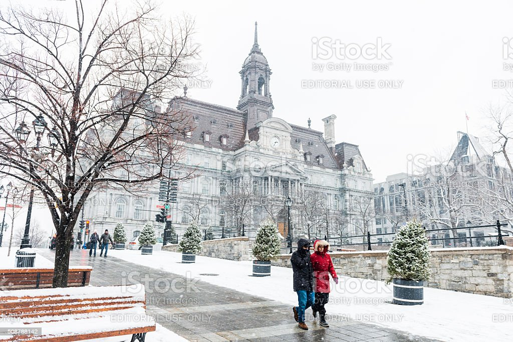 People Walking in Old Montreal on Cold Snowing Winter Day stock photo