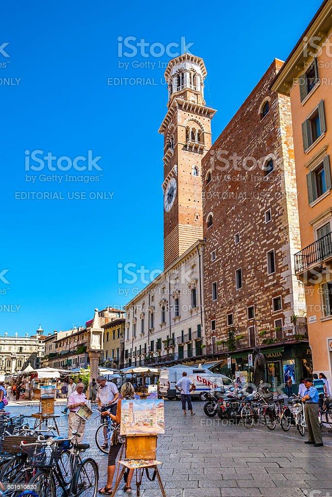 People walking in Piazza delle Erbe stock photo