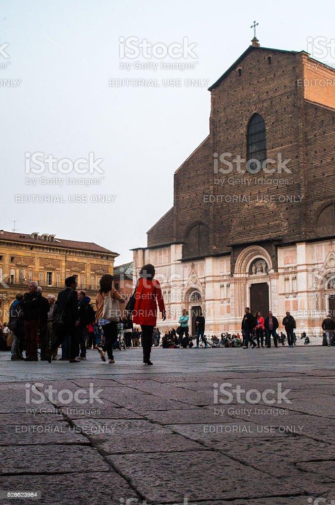 People walking in Piazza Maggiore Bologna near Saint Petronio cathedral stock photo