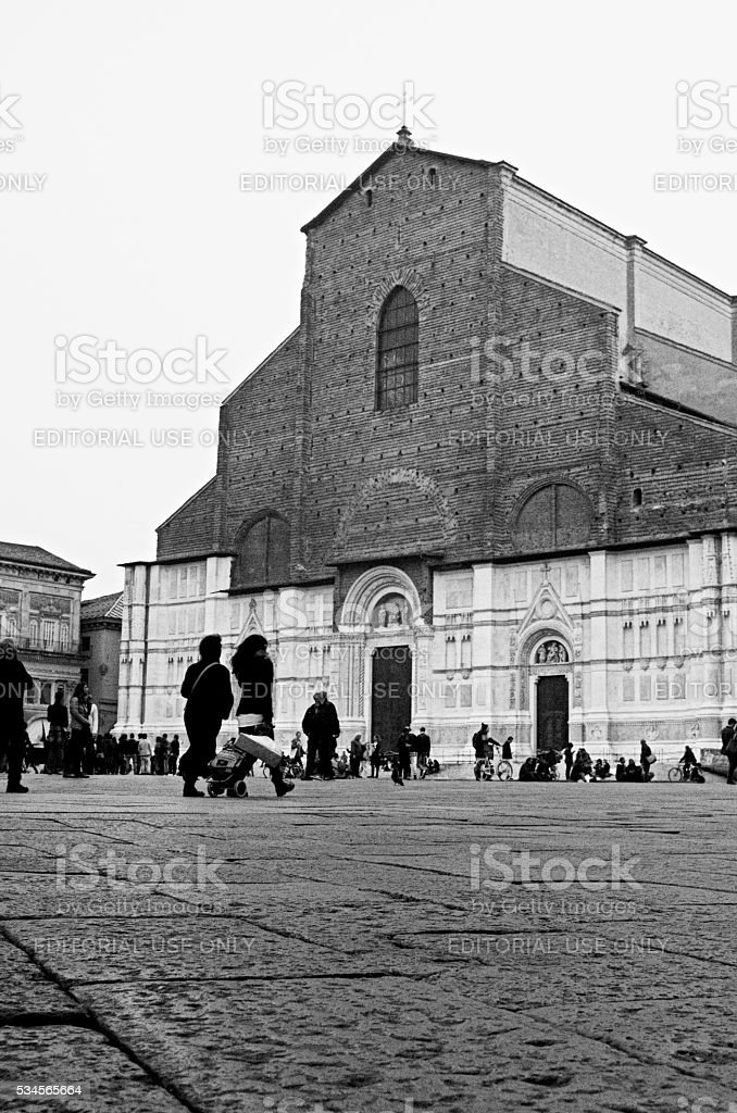 People walking in Piazza Maggiore in the evening in Bologna stock photo
