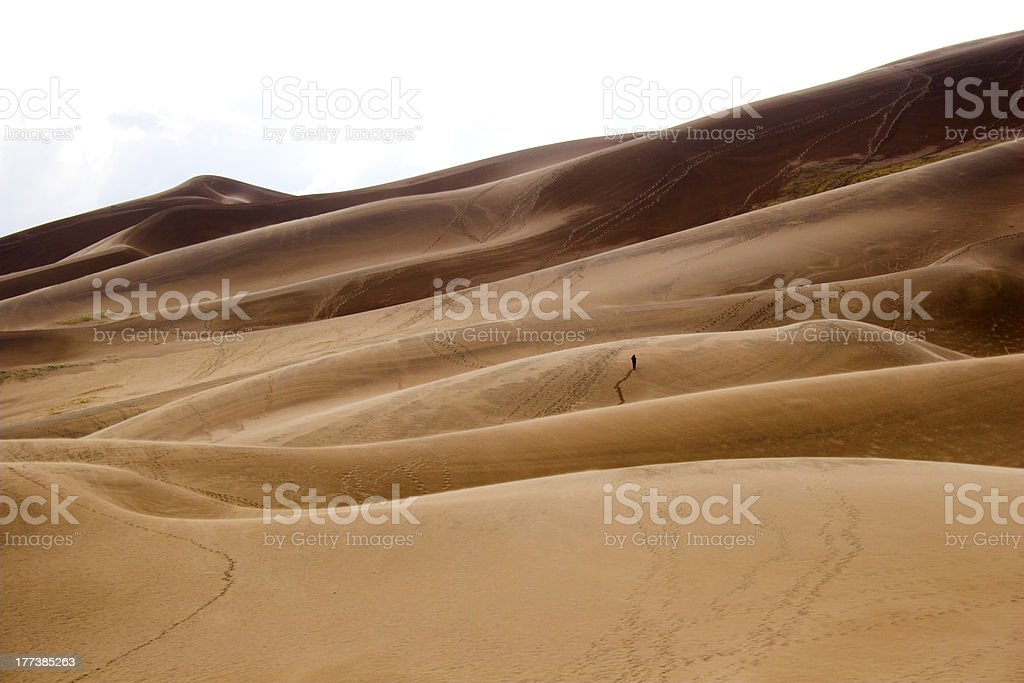 People walking in sand dunes royalty-free stock photo