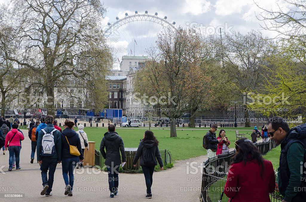 People walking in St-James's Park with London Eye stock photo
