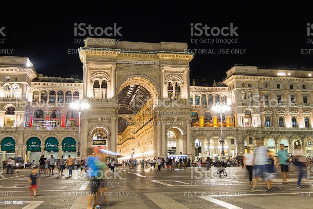 People walking in the Duomo Square by night, Milan stock photo