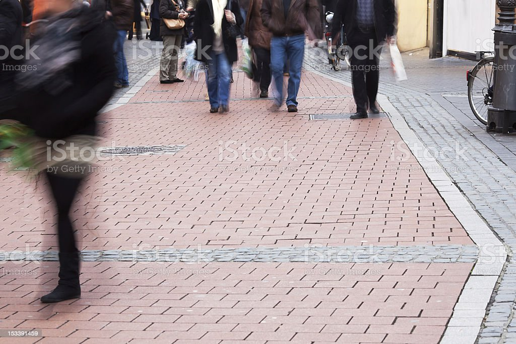 people walking in the pedestrian area royalty-free stock photo