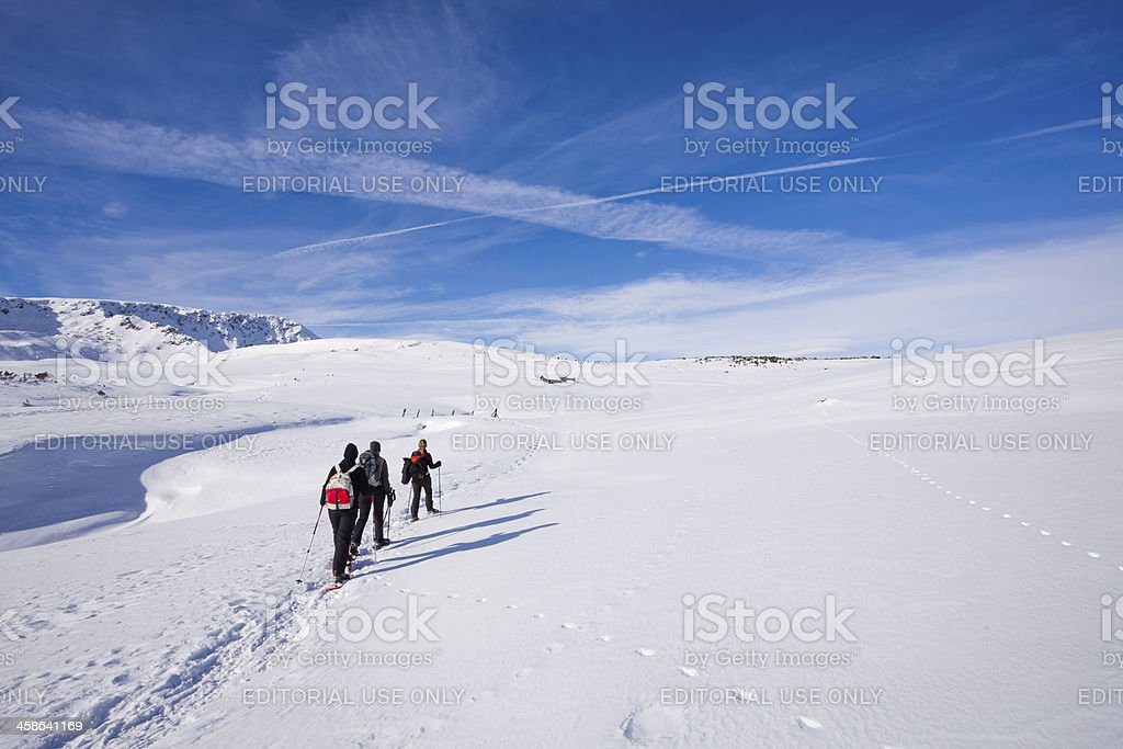 People Walking in the Snow, Dolomites, Italy royalty-free stock photo