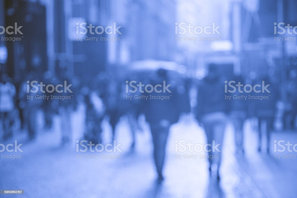 people walking in the street, blue blurry stock photo
