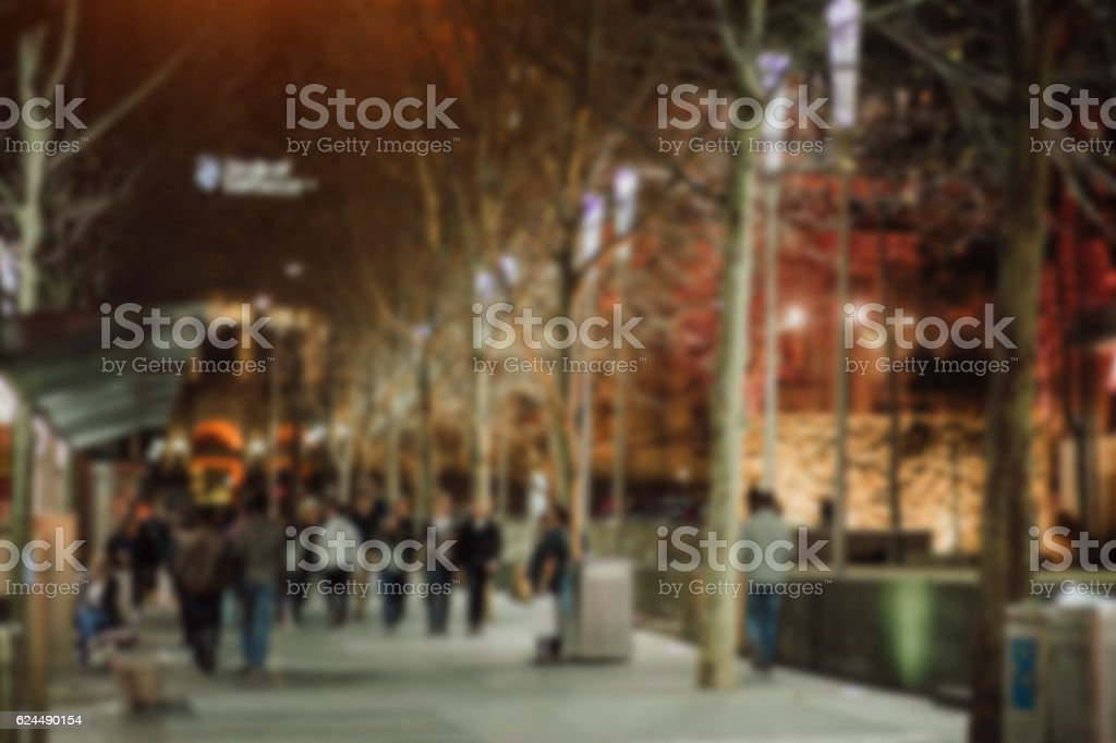 people walking in the street, blurry for background stock photo