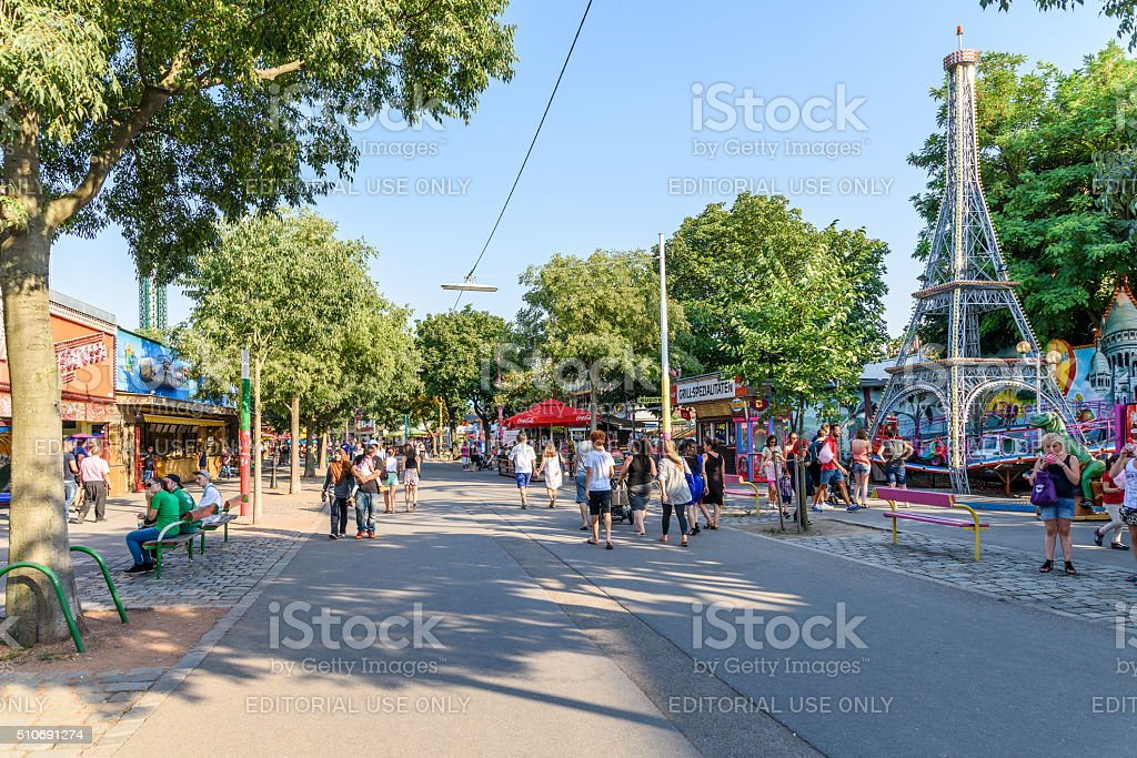 People walking In Wurstelprater or Prater Park stock photo
